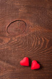 Two red hearts on wooden background Stock Photography