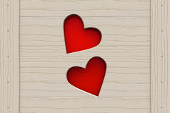 Two red hearts in a wooden board Royalty Free Stock Image
