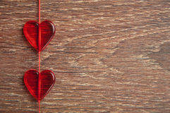 Two red hearts on the wooden board Royalty Free Stock Photos