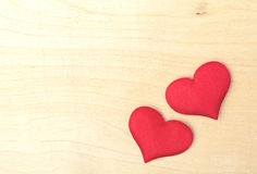 Two red hearts on a wooden  board Stock Image