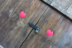 Two red hearts on wooden rustic background with padlock Stock Photo