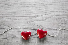Two red hearts on a wooden shabby background for valentine. Stock Photography