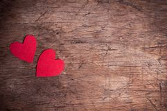 Two red hearts on wooden table Stock Photography