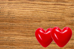 Two red hearts on wooden texture close-up Royalty Free Stock Images