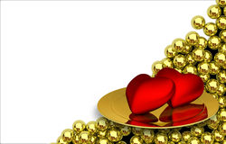 Two red heartson plate and glossy golden spheres Stock Images