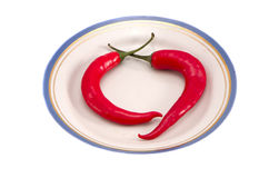 Two red hot chili pepper dish. Healthy nutrition Royalty Free Stock Photo