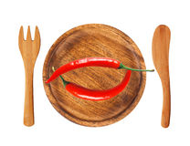 Two red hot chilli peppers on wooden background isolated on whit Royalty Free Stock Photography
