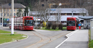 Two red Innsbruck tram Royalty Free Stock Photography