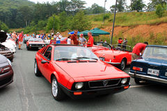 Two red italian lancia sports cars at angle riding back to back Royalty Free Stock Photos