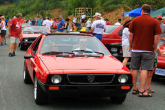 Two red italian lancia sports cars riding back to back Royalty Free Stock Image