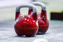Two red kettlebell are on the floor Stock Photography