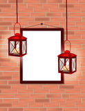 Two Red lanterns with candles and  place for text on red brick Royalty Free Stock Photos