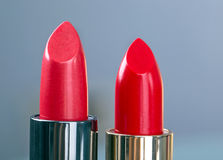 Two red lipsticks Royalty Free Stock Photos