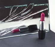 Two red lipsticks, perfect versus imperfect symbolic concept ide. A, detail, macro Royalty Free Stock Photo