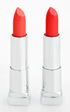 Two red lipsticks on white. Two red lipsticks isolated on white royalty free stock photo