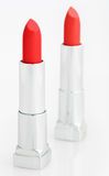 Two red lipsticks on white. Two red lipsticks isolated on white royalty free stock image