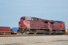 Two red locomotives at a freight yard. Two red diesel locomotives at a freight yard Stock Photos