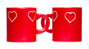 Two red love heart mugs Stock Photography