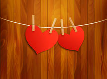 Two red loving hearts hanging on a rope. Royalty Free Stock Photography
