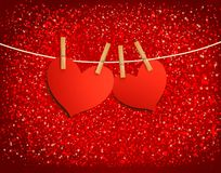 Two red loving hearts hanging on a rope. Stock Images