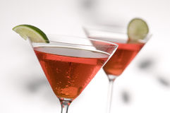 Two red martinis. With lime, focus is on front glass Royalty Free Stock Photos