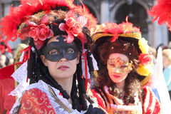 Two red masked women at Carnival of Venice Stock Photography