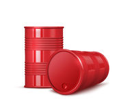 Two red metal barrels on white background Stock Photography