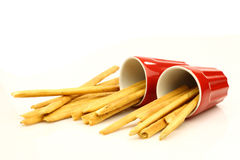 Two red mugs with Italian bread sticks Royalty Free Stock Photography