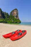 Two Red Ocean Kayaks on Sunny at the beach Stock Images