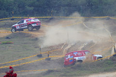 Two red off-road vehicle race pace Royalty Free Stock Photography