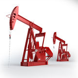 Two Red Oil pumps Stock Images