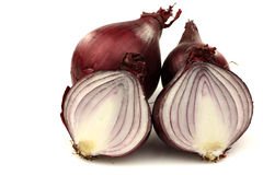 Two red onion halves and two whole ones Stock Image