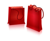 Two red package for shopping. With handles - with ropes Stock Photography