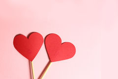 Two red paper heart on wooden stick together Royalty Free Stock Photography