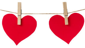 Two red paper hearts hanging Stock Image