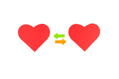 Two red paper hearts with two colored arrows, concept relationsh Stock Photography