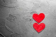 Two Red paper hearts upright on gray wall with copy space. Two Red paper hearts on gray wall with copy space Happy Valentine background royalty free stock photography