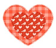 Two red patchwork hearts. Sewed together Stock Photo