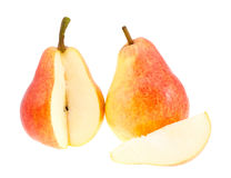 Two red pears with a segment. Royalty Free Stock Photos