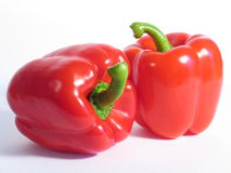 Two Red Peppers. On a white underground Stock Photography