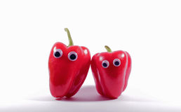 Two red peppers with googly eyes Royalty Free Stock Images