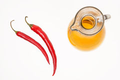 Two red peppers and olive oil. On white background Stock Image