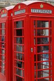 Two red phone booth. Traditional red phone booth in a street of London Royalty Free Stock Image