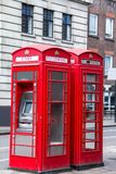 Two red phone booths on the street.. London Stock Photo