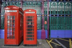 Two red phones. Two red phone boxes at smithfields meat market, london stock photo