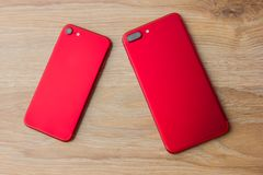 Two red phones on the desk. Royalty Free Stock Photos