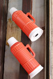 Two red plastic thermos bottles Stock Photos