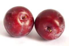 Two red plums Stock Photos