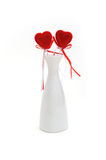 Two red plush hearts in white vase Stock Photos