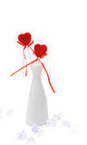 Two red plush hearts in white vase Royalty Free Stock Images